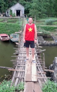 Andy on the bridge across the river