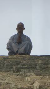 a Monk waiting for us at the top of the stairs